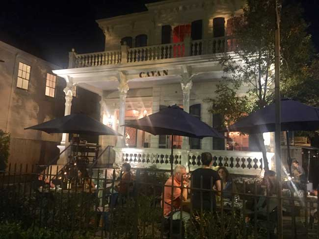 Enjoying dinner on the patio at Cavan in New Orleans. Photo by Janna Graber