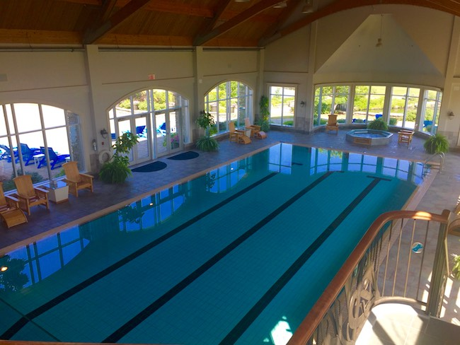 Junior Olympic-size indoor pool with hot tub and mineral pool. Photo by Claudia