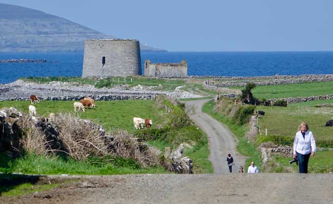 Group Travel in Ireland: Driftwood passengers explore an ancient tower in Ireland. Photo by Robert N. Jenkins