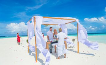 Wedding ceremony at The Sandbank, a tiny slip of land just a few minutes from Baros Maldives. Photo by Muha Photos.