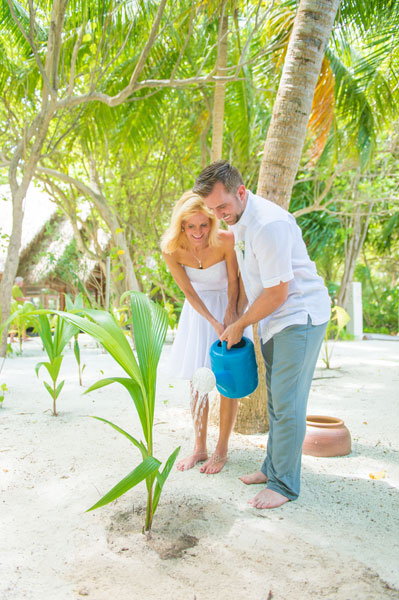 Planting a palm tree at Baros Maldives to symbolize how our relationship will grown. Photo by Muha Photos