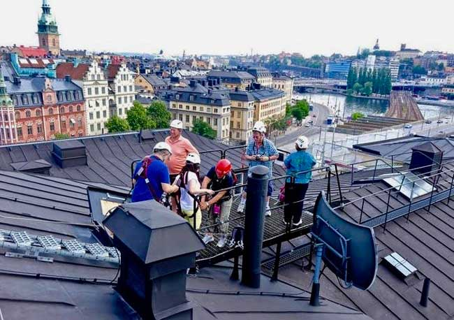 We hold our tether with one hand and follow the leader across the roofs of Stockholm, Sweden. Photo by Robert N. Jenkins