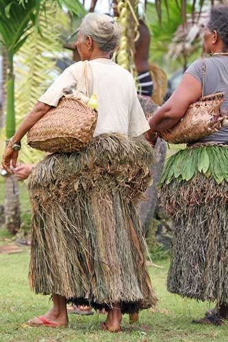 Yap travel - Yapese elders in traditional grass skirts. Photo by Joyce McClure