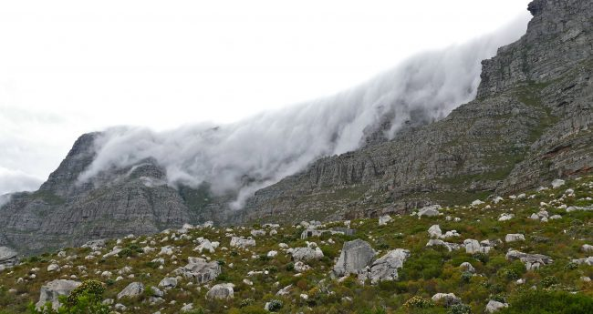 The clouds hanging over Table Mountain. Photo by Flickr/berniedup