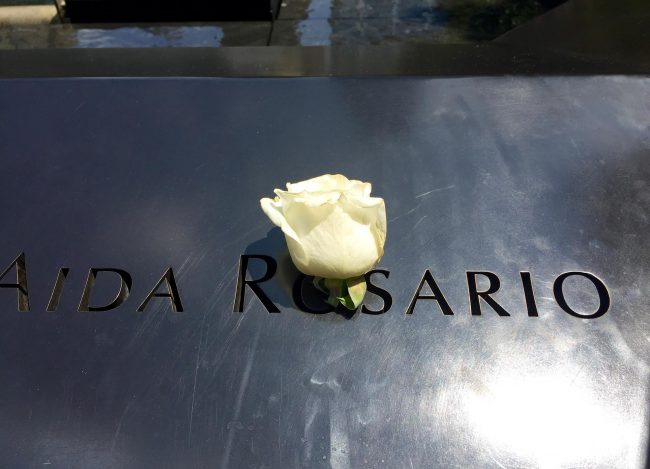 9/11 A single rose honors this woman whose name is etched in bronze at the Memorial Pool. Photo by Claudia Carbone