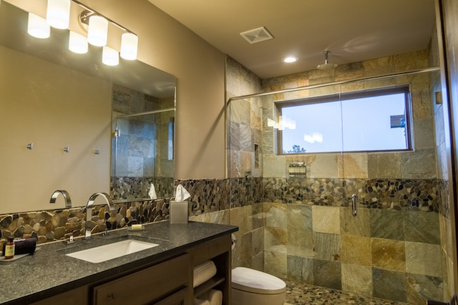 Luxurious bathroom with inlaid stone decor. Photo courtesy of Echo Canyon River Expeditions