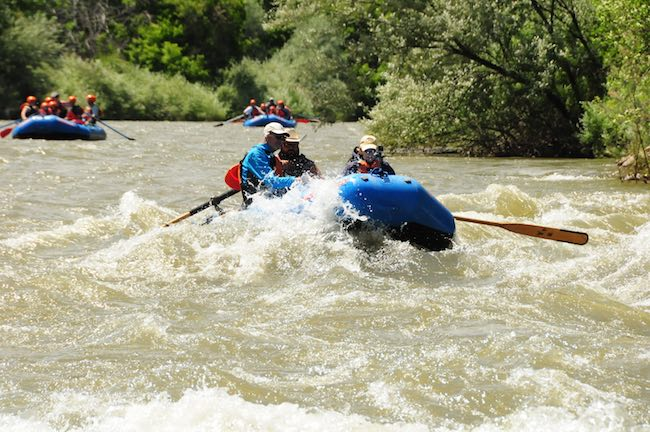Riding the waves. Photo courtesy of Echo Canyon River Expeditions.