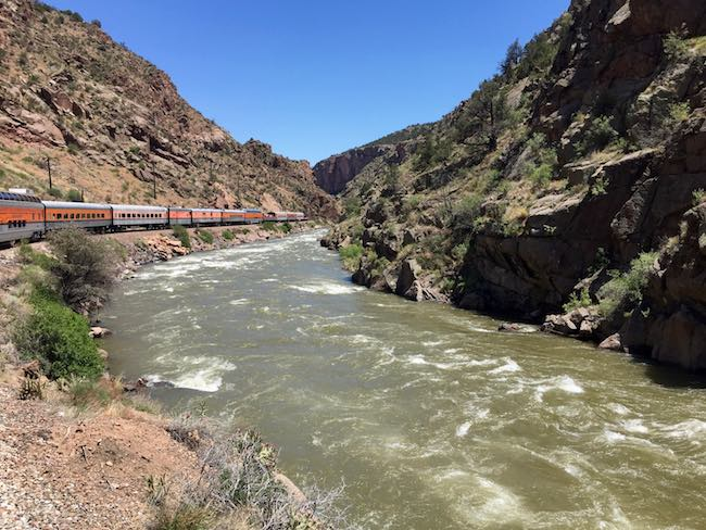 Royal Gorge RR running along the Arkansas River. Photo by Claudia Carbone