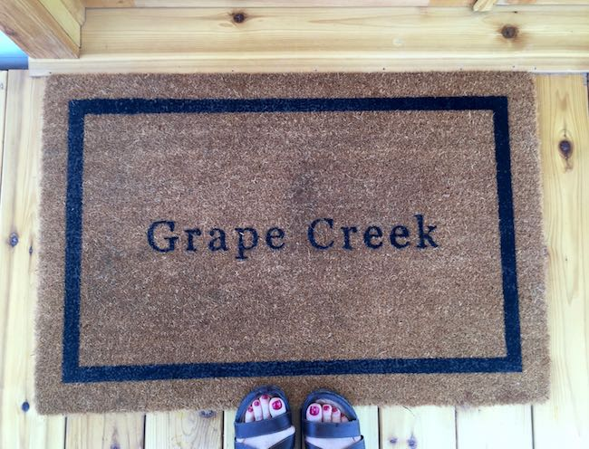 Door mat with the name of the tent. Photo by Claudia Carbone