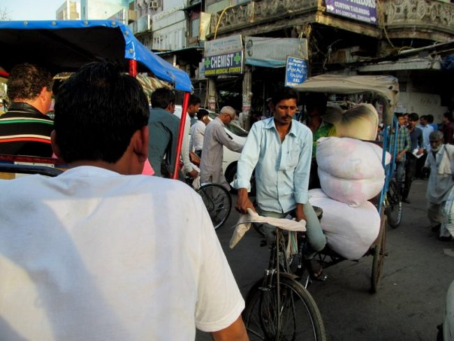 Old Delhi. Often the passenger on a rickshaw is a bale of cotton. Photo by Carol Bowman