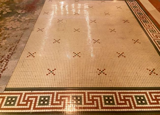 Mosaic tile lobby floor. Photo by Claudia Carbone