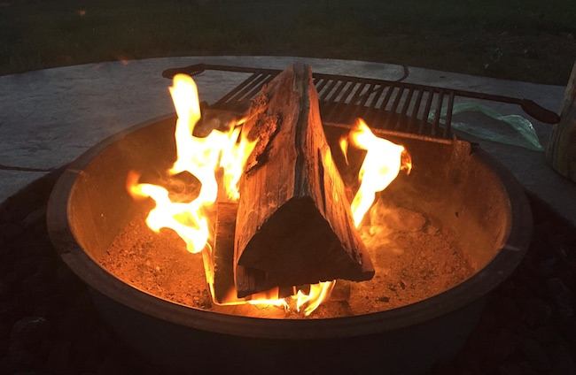 Fire pit next to tent. Photo by Claudia Carbone
