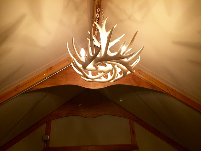 Chandelier above the bed. Photo by Claudia Carbone