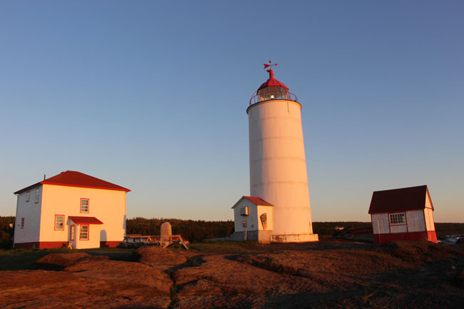 The sun begins to set on the lighthouse, which is now a B&B, on Ile Verte. Photo by Janna Graber
