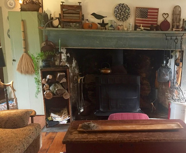 Fireplace antiques in the living room of Olde Rhinebeck Inn. Photo by Claudia Carbone