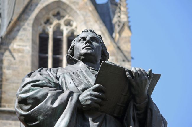 "Many town squares in Germany are dominated by statues of Martin Luther. This one is in Erfurt, the city Luther called ""my spiritual home,"" because of his years spent there as a monk in St. Augustine's Monastery (Photo credit: Christiane Würtenberger)"