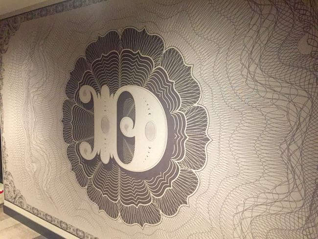 Hall wallpaper is a copy of a banknote from Denver's past. Photo by Claudia Carbone