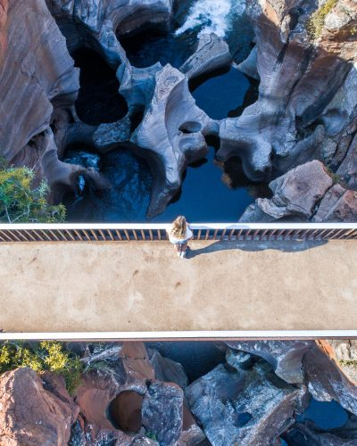 Mpumalanga Panorama Route in South Africa Peering over the bridge at Bourke's Luck Potholes. These crevices are a result of water flowing through this rocky landscape for hundreds of years. Photo by Luke Maximo Bell
