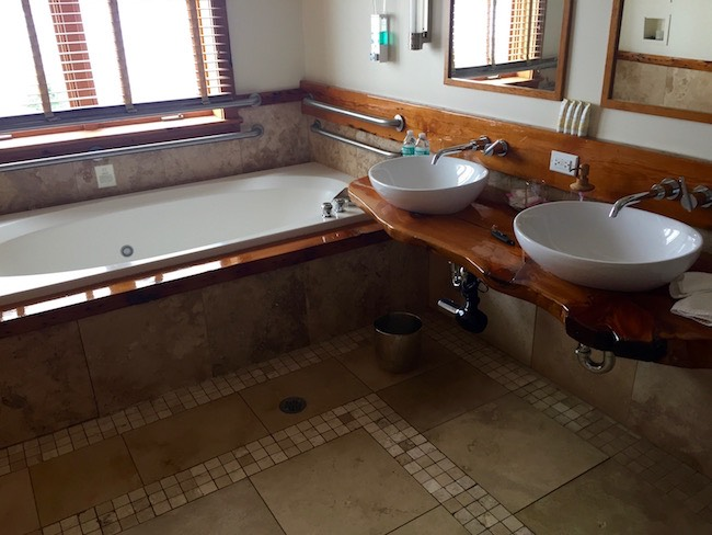 Full bathroom with double sinks. Photo by Claudia Carbone