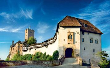 Wartburg Castle, where Luther spent 10 months hiding from potential assassins after the pope declared him a heretic, stands on a mountaintop high above Eisenach. (Photo credit: Anna-Lena Thamm — Thüringer Tourismus GmbH)