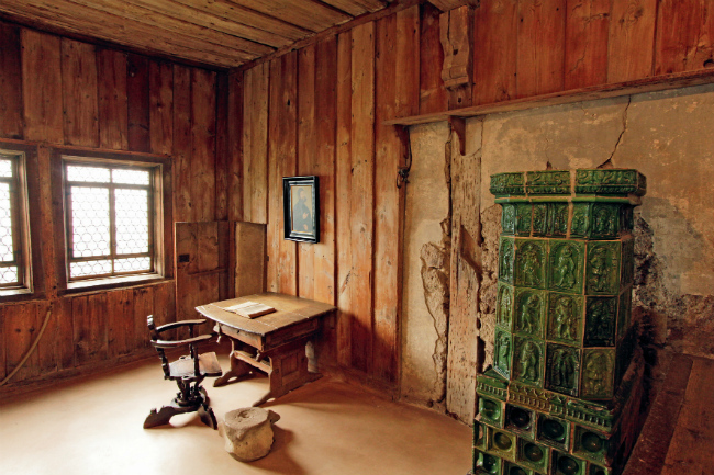 This simple room inside Wartburg Castle is where Luther lived and began his translation of the Bible during the 10 months he resided there. He used the huge whale vertebra on the floor as a footrest. (Photo credit: Andreas Weise — Thüringer Tourismus GmbH)