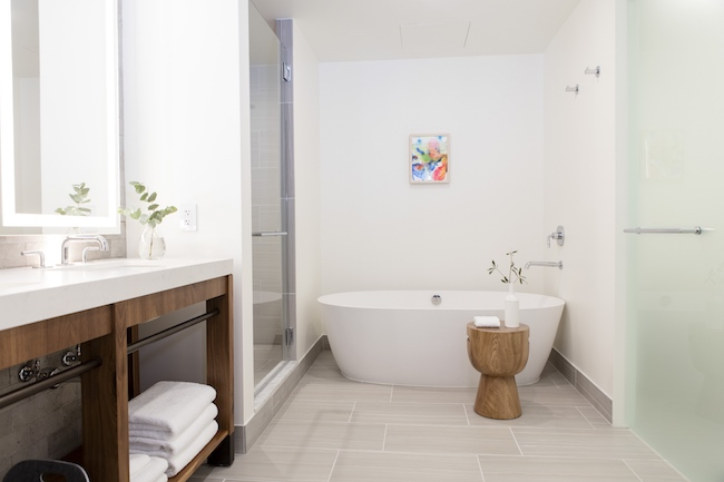 Bathroom with soaking tub. Photo courtesy of Kimpton Hotel Born