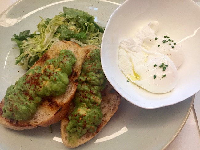 Poached eggs with greens and avocado toast. Photo by Claudia Carbone