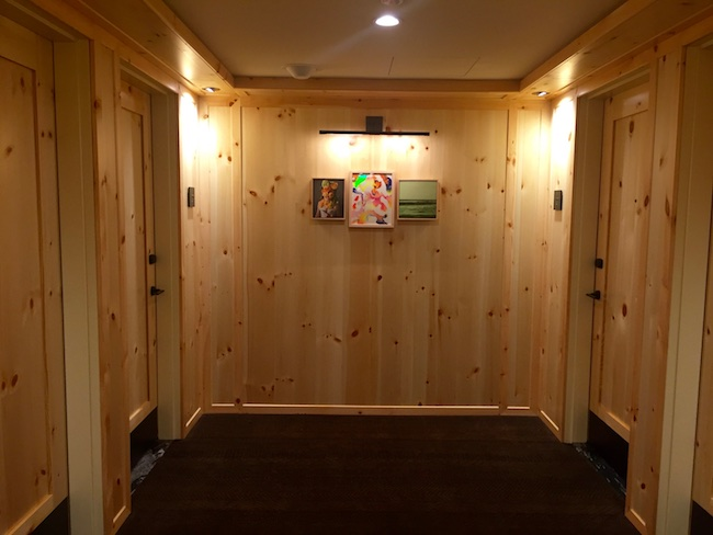 Knotty pine paneling and doors in the hallways. Photo by Claudia Carbone