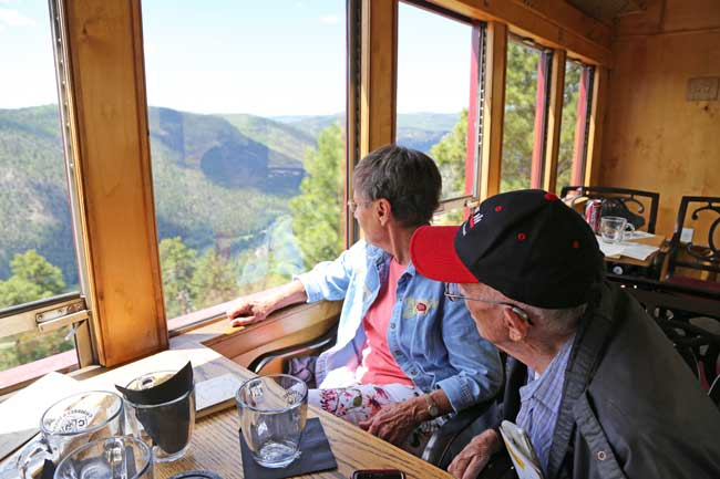 The author's parents enjoy the view from the Deluxe Tourist Car aboard the Cumbres & Toltec Scenic Railroad. Photo by Benjamin Rader