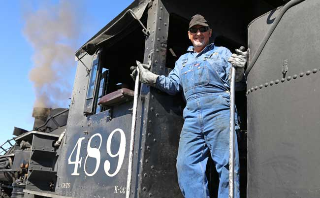 A train engineer aboard the Cumbres & Toltec Scenic Railroad. Photo by Benjamin Rader