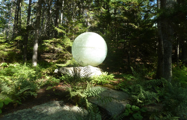 Chiseled glass orb at Coastal Maine Botanical Gardens. Photo by Michael Schuman