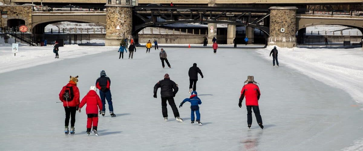 Family ice-skating on the Rideau Canal in Ottawa, Canada