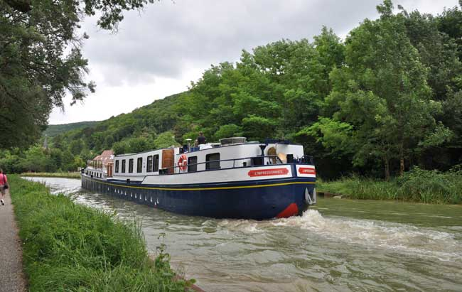 The L'Impressionniste, a luxury hotel barge by European Waterways, cruises through Burgundy, France. Photo by David Powell
