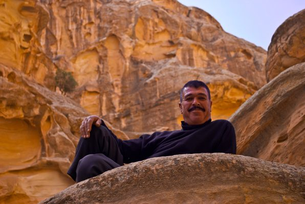 A man smiles near Little Petra. Photo by Christine Loomis