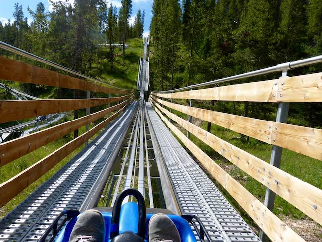 "I'm riding the ""Forest Flyer"" alpine coaster through the trees with gorgeous views of the Gore Range. Photo by Claudia Carbone"