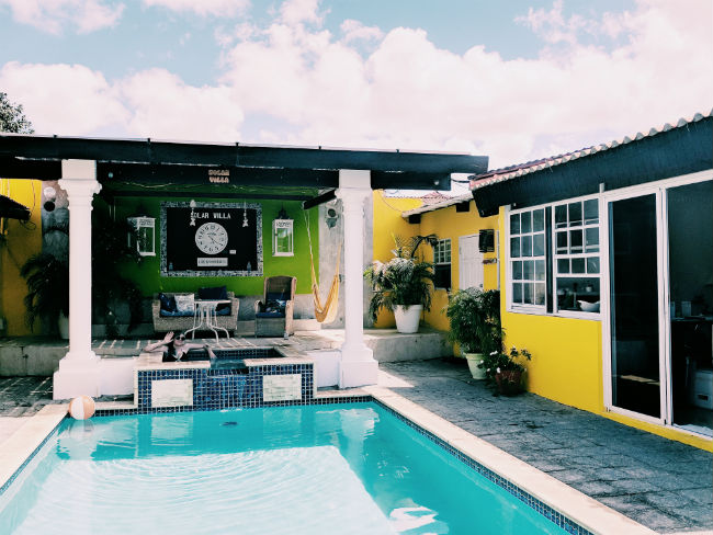 Aruba Located a 5-minute drive from Eagle Beach, Solar Villa offers an outdoor swimming pool and tropical gardens. Central Oranjestad is just a 3-minute drive away. Solar panels line the roof and heat the water. Photo by Kelsey Nelson