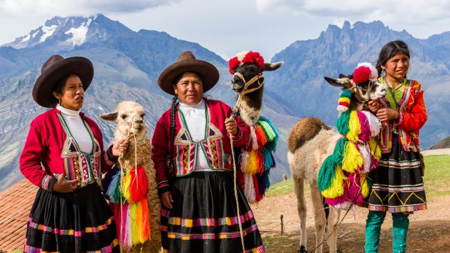 Travel in Peru. Locals and llamas in Urubamba, Peru. Photo by Flickr/Steven dosRemedios