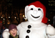 Travel writer Claudia Carbone with Bonhomme, the ambassador of the Quebec City Winter Carniva