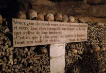 A sign warning those who enter the Paris catacombs. Photo by Clare Radcliffe Thorne