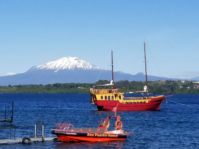 We could see the volcanoes from the banks of Puerto Varas. Photo by Linda Ballou