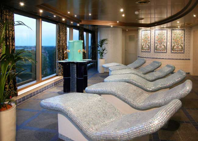 Evergreen Spa guests listen to soft music as they relax on heated lounges in the thermal suite. Photo by Holland America Line