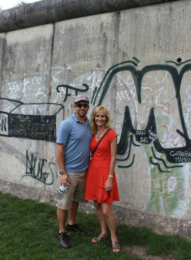 The author and her husband visiting the Berlin Wall today.