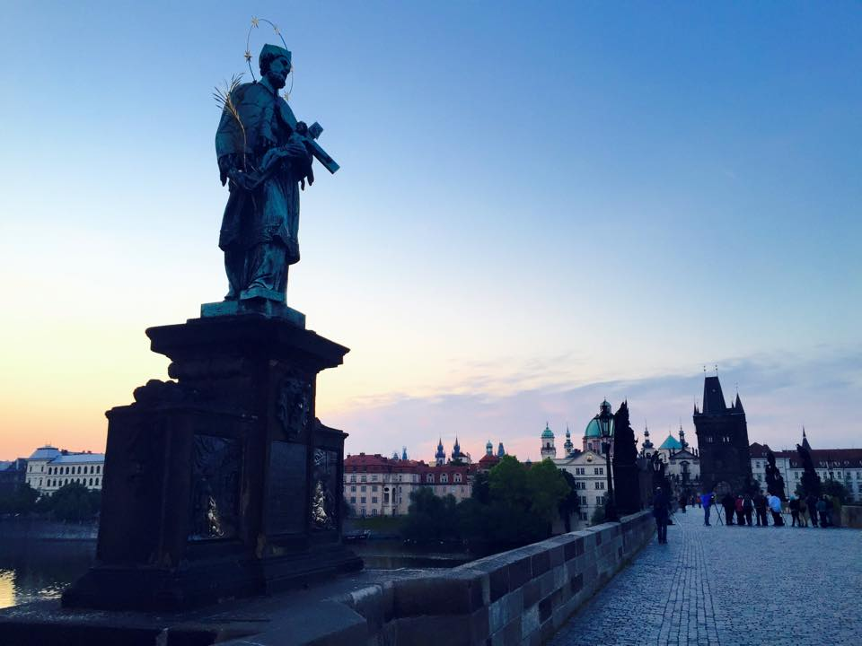 St. John of Nepomuk statue on Prague's Charles Bridge. If you touch certain parts of the statue, it is said to bring good luck and a safe return to the city. Photo by Morgan Statt