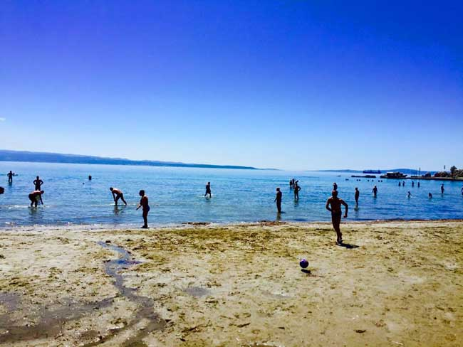 Watching the locals play soccer on Bacvice Beach in Split, Croatia. Photo by Morgan Statt