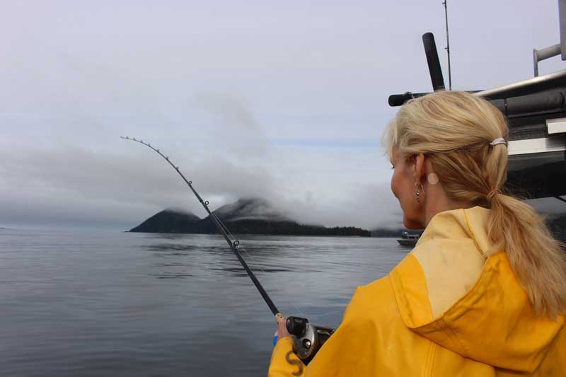 The author learning to fish in Alaska. Photo courtesy Janna Graber