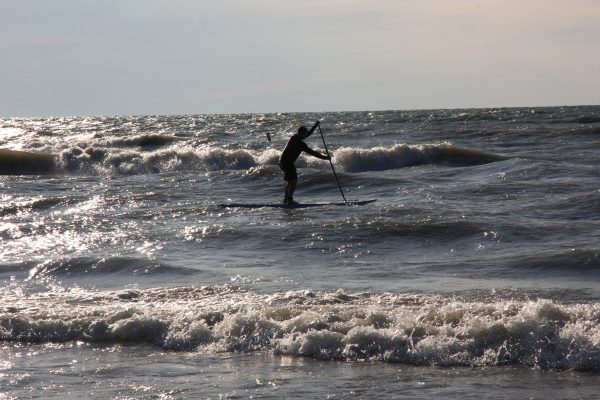 SUP on the waves of Lake Huron in Ontario. Photo by Scott Arseneault