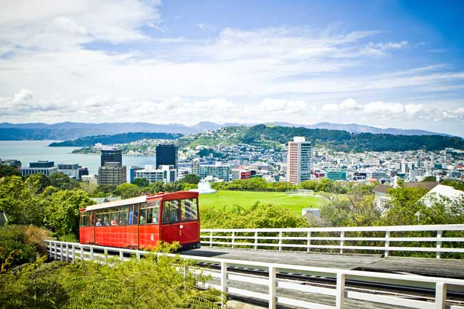 A cable car makes its way uphill on a sunny day in Wellington, New Zealand.
