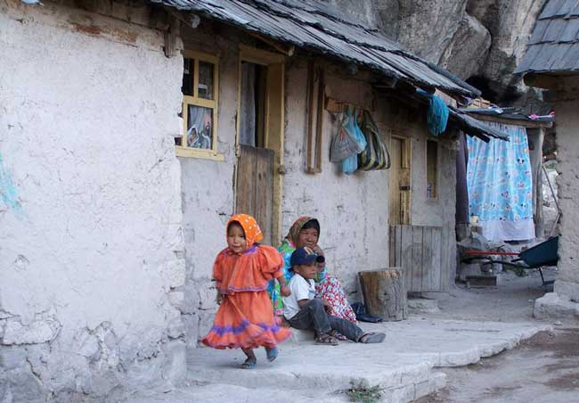 Tarahumara Indians live in homes nestled into mountain crevices. Photo by Carol L. Bowman