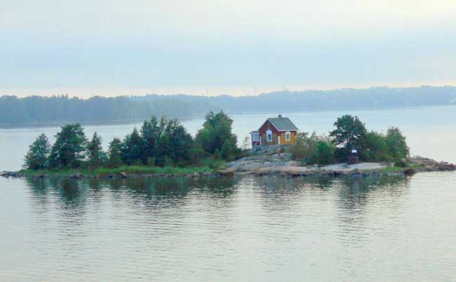 The first sign of St. Petersburg, a family owned dacha on an island emerged from the Gulf of Finland. Photo by Carol L. Bowman