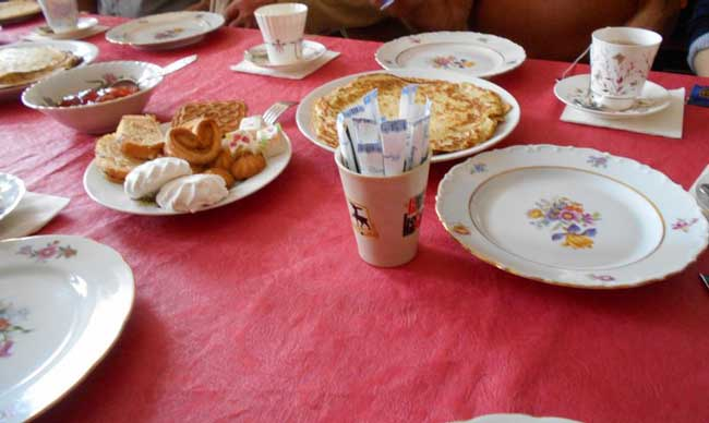 Tables set with mismatched china, freshly made Russian blintzes tempted our taste buds. Photo by Carol L. Bowman